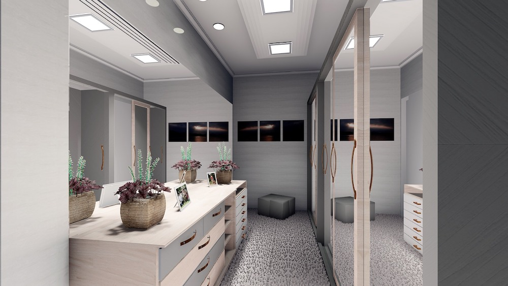 Master bedroom walk in closet with coordinated cabinets, countertop and shelves.