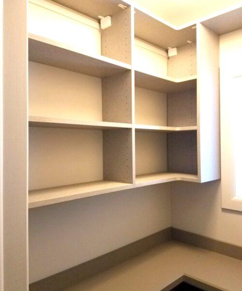 Small pantry, upper shelves.